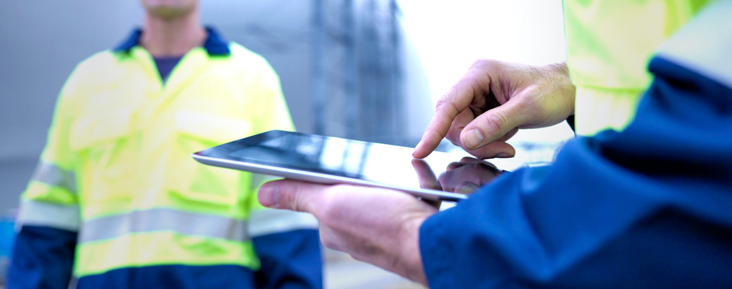 Facility employee holding tablet device