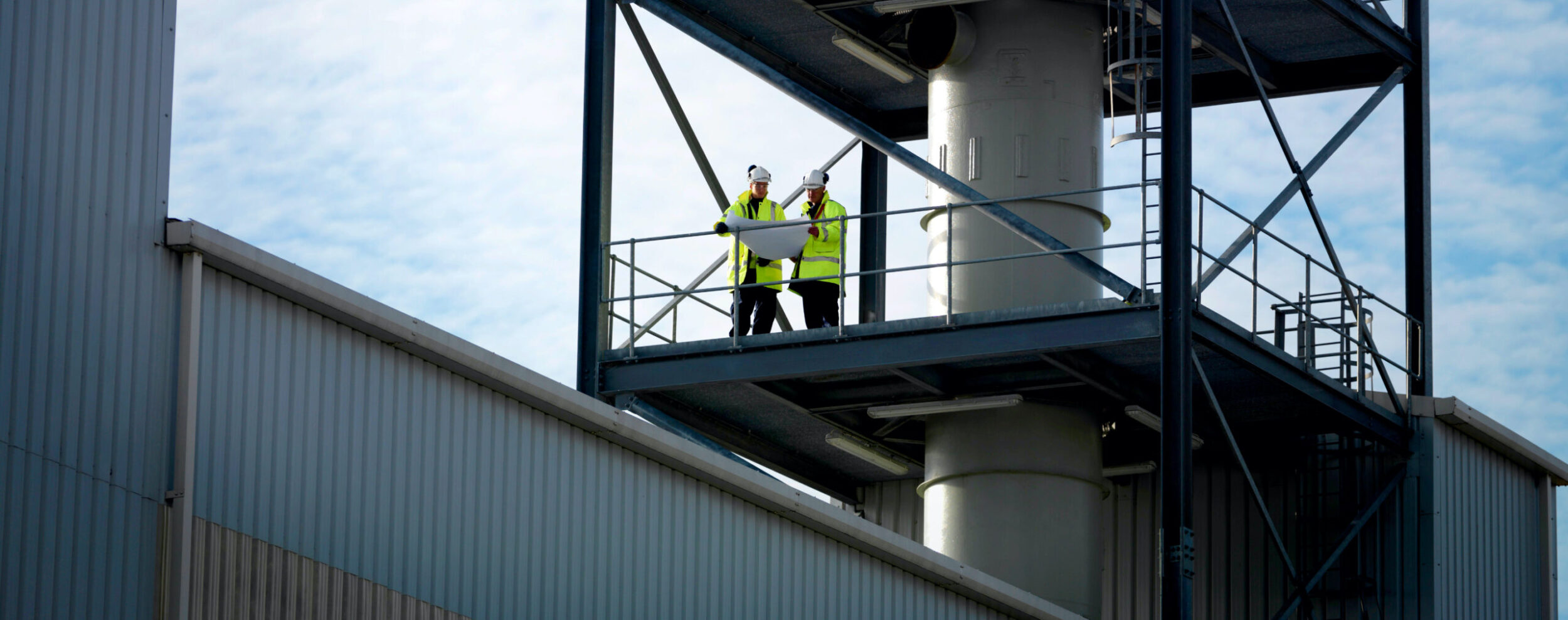 Facility employees on an inspection platform