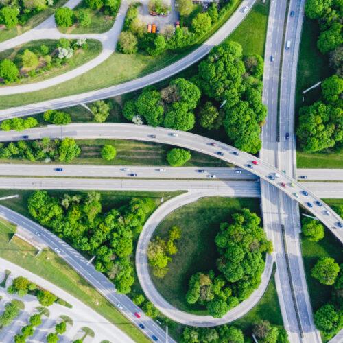 Aerial view of motorway junction set amongst trees