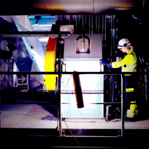 Woman wearing high-vis jacket inside a waste to energy facility