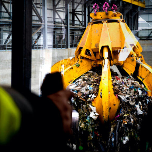 Overhead residual waste cranes moving non-recyclable waste